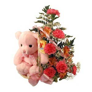 Flower and teddy arrangement to welcome a new baby and congratulate the new parents