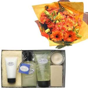 Hand tied bouquet of flowers and pampering gift set